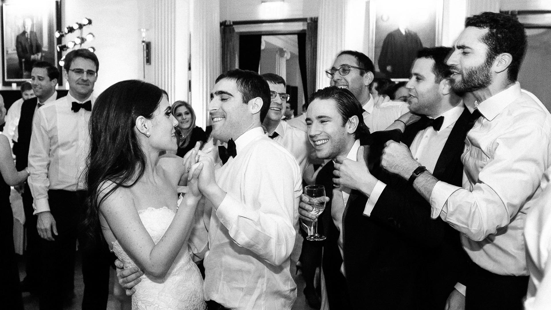 bride groom dancing with friends