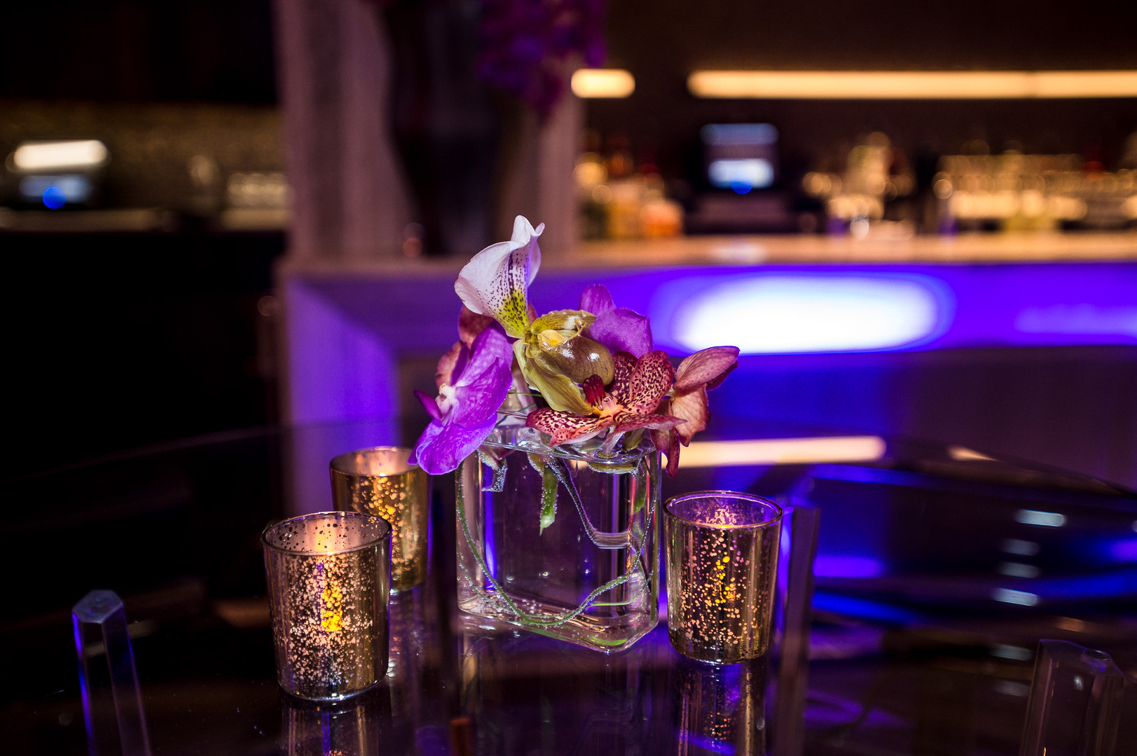 small orchid ladyslipper centerpiece at SixtyFive Bar and Lounge
