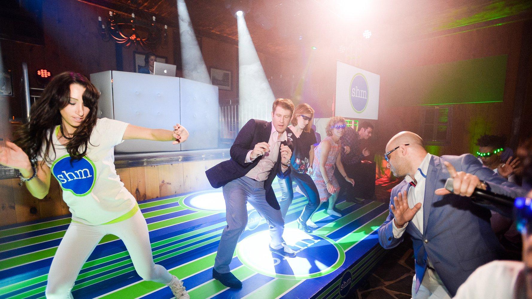 Bar Mitzvah adults on raised dance floor